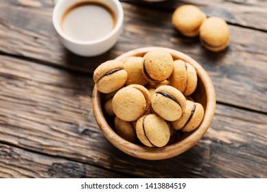 Baci di dama italian hazelnut biscuits cookies with chocolate cream, rustic style