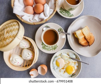 Back in the 50's,Hailan coffee shop that served authentic breakfast  / Retro Coffee Shop Meal / Toasted bread with kaya spread and refrigerated butter,half boiled eggs,steamed bao and coffee with milk