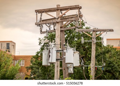 Back Alley, Wooden Telephone Pole with Power Lines and Transformers.