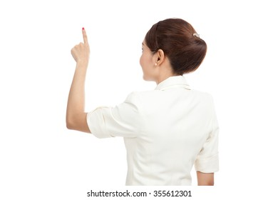 Back of Asian business woman touching the screen with her finger isolated on white background  isolated on white background