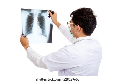 Back of Asian male doctor wear mask look at x-ray film  isolated on white background