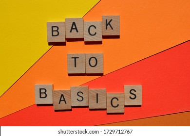 Back to Basics in 3d wooden alphabet letters  isolated on orange and red background