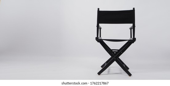 Back of black director chair use in video production or movie and cinema industry on white background.