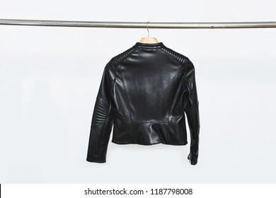 Back of black leather jacket on hanger