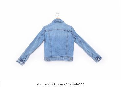 Back of blue denim jacket isolated on hanging