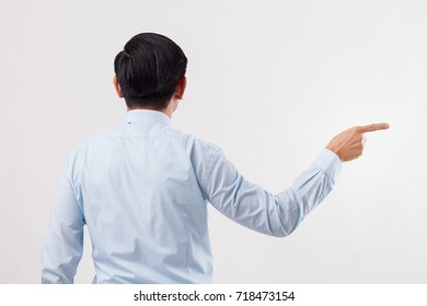 back of business man pointing side away to blank space