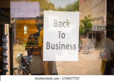 Back to business poster or signage sticked in front of store door - concept of reopening business after coronavirus or covid-19 pandemic lockdown crisis. - Shutterstock ID 1734577727