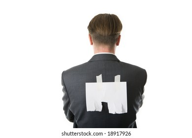 Back of businessman with white piece of paper on it