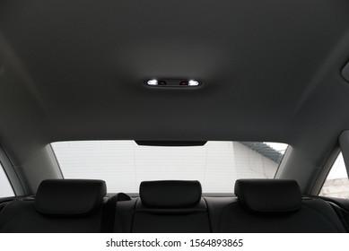 The back of the car interior. Views of lighting elements, glazing, head restraints - Shutterstock ID 1564893865