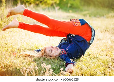 back to childhood - happy woman playing on the grass