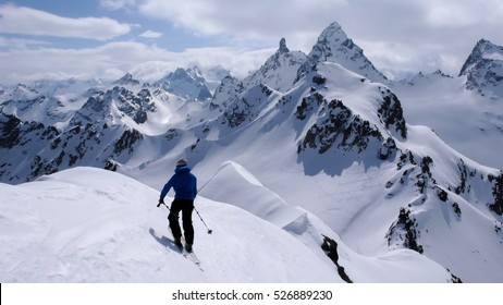 back country skier surrounded by mountains in the Silvretta massif in the Austrian alps
