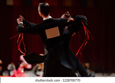 back couple dancers waltz in competitive dancesport