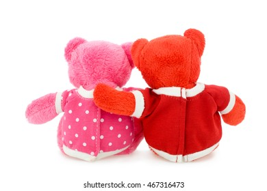 Back of couple of hugging teddy bears. Isolated on white background.