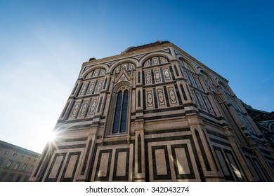 The back of the duomo in Florence with sun flare.