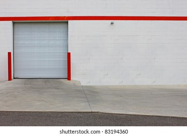 A back entrance loading dock for a business with room for your text.