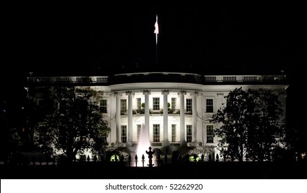 Back facade of the White House at night