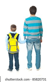 Back of father and son going to school isolated on white background