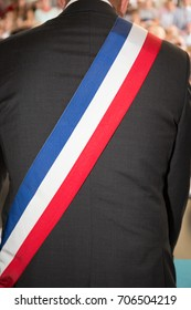 Back of French mayor man with a scarf flag