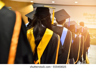The back of the graduates are walking to attend the graduation ceremony at the university,Concept of Successful Education in Hight School,Congratulated Degree