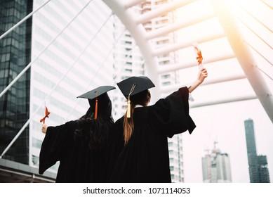 The back of the graduates wear cap at university.