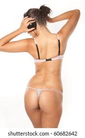 Back of Happy woman enjoying music wearing sexy lingerie