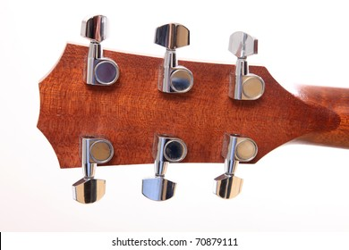 Back of the headstock of the guitar over white background