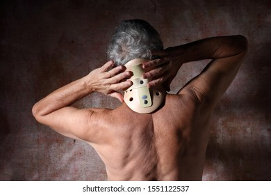 Man's back with his hands on cervical collar for neck pain.
