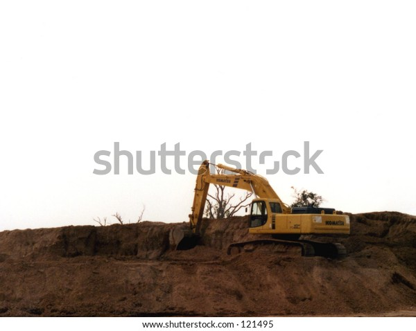 Back Hoe in a Dirt Pile