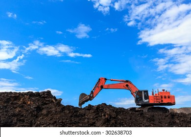 Back hole and Coal in Blue Sky
