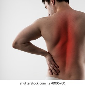 Back inflammation and ache. Young man suffering from backbone disease or spasm.