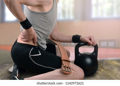 back injury during exercise. back pain. backache. weight-lifting