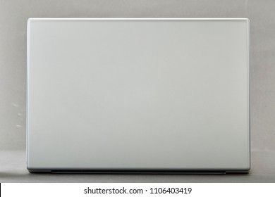 back of laptop is on the white background, Technology concept