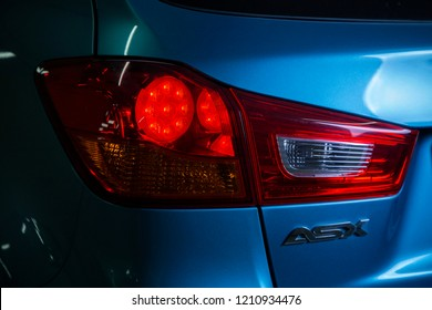 Back Light of a Blue Mitsubishi ASX, Model 2013 - April 2016: ASX Mitsubishi SUV picture taken in Parking slot in Abu Dhabi UAE with Studio Lights