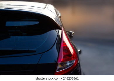 Back light of city car on the street background