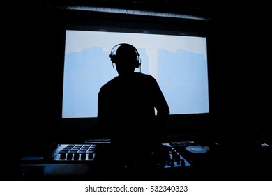 Back light DJ with headphones