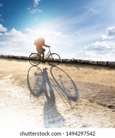 Back lit cyclist on blue sky in early spring