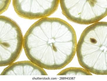 back lit fresh organic lemon slices background