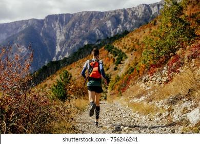 back male runner skyrunner running mountain marathon