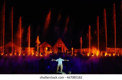 Back of a man with background of colorful fountain
