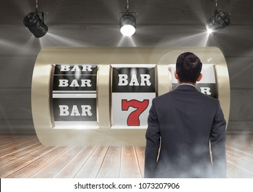 Back of Man Looking at casino slot machine