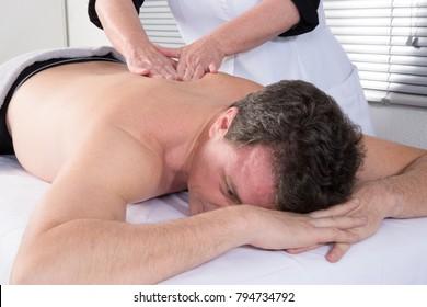 back man massage by woman masseuse professional