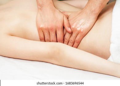 Back massage on back of woman in spa salon.