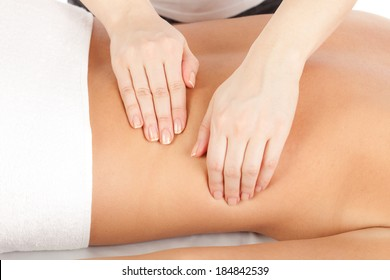 Back massage as therapy, studio shot