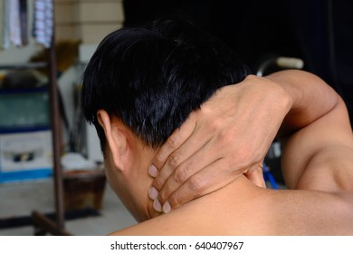 back of neck neck pain concept with a muscle man