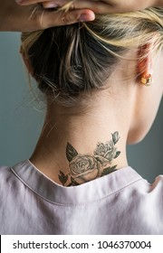 Back neck tattoo of a woman
