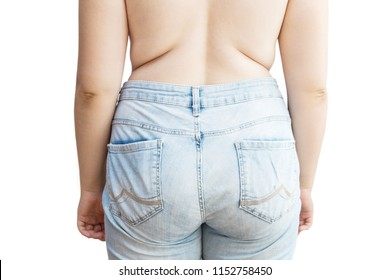 Woman's back on white background. Girl in jeans with excess weight. Excess fat. Isolated on white