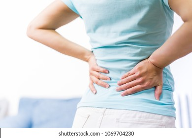 back pain at home. women suffer from backache. healthcare and medical concept