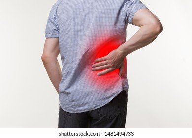 Back pain, kidney inflammation, man suffering from backache, painful area highlighted in red