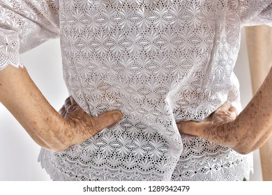 Back pain, lumbar pain of the elderly.Diseases that older people tend to be.Asian women having back pain.eldery health care concept.