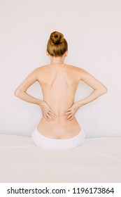 Back pain treatment of young woman. Body care.